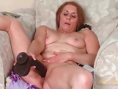 Big black dildo fucks shaved mature cunt porn video