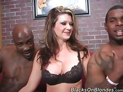 Divine milf is under two huge black monster cocks