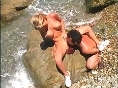 Big tittied Kiri gets banged on a rock on the shore