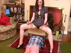 Dominant brunette punishes her slave