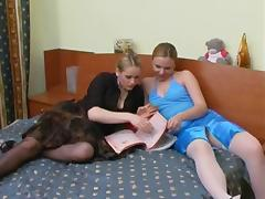 Two blonde dominatrices fuck a guy with a strapon