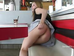 Curvy Danielle shows her tits and boobs in public places