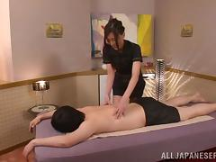 A Japanese chick gives a massage and then has sex with a guy