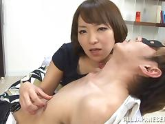 Japanese milf gives hand to some guy and lets him lick her big tits