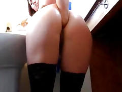 Horny slut fisting her ass while brushing her teeth