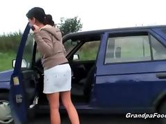Cute babe seduces grandpa on the road