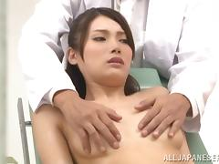Japanese cutie gets her pussy fingered and toyed by a doctor