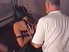 strictly bound corseted lady in leather