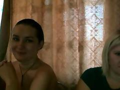 Sexy lesbian couple playing at home
