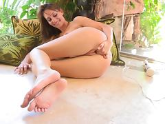 Leann fingers her wet pussy after playing with her toes