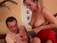 A blonde MILF in a red negligee gets nailed on a sofa