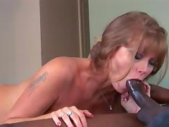 Mom Darla Crane sucks a big black cock