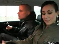 Married couple foreplay in a fake taxi
