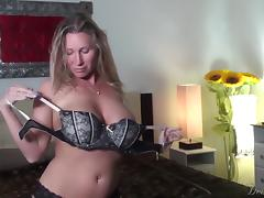 Busty blonde milf sucks on a big cock until it cums in her mouth