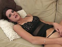 Rhiannon Bray moans while masturbating with a dildo on a couch