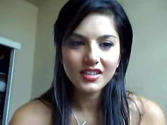 Sunny Leone toys her shaved pussy in front of a webcam
