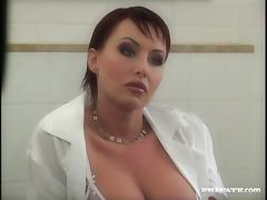 Short-haired mom Sandra Iron masturbates her pierced vag in a bathroom