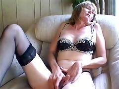 Old milf rubbing her clit