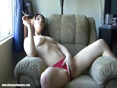 Brown-haired tart smokes and fingers her smooth coochie indoors