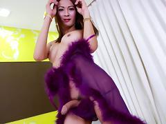 Skinny Asian shemale Toon masturbates her wang indoors