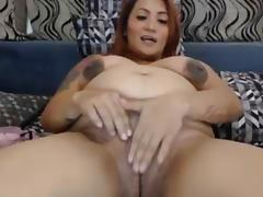 Cute pregnant Latina teasing with dildo on webcam