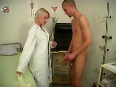 Short-haired doctor seduces a patient and fucks him at her work place