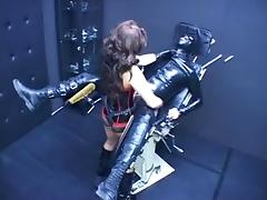 Wicked brunette fucks her thralls in latex