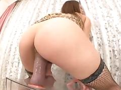 Asian slut humping a big sex toy