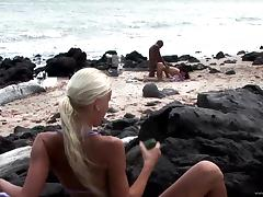 Sensual brunette Roxy Panther jumps on a BBC on a beach