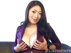 Mature Japanese babe shows off her amazing, big tits