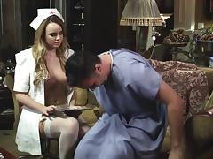 Sexy nurse with an awesome body sucking a patient's huge cock