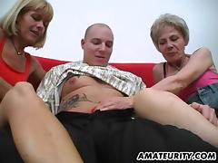 Two lustful mature blondes share the cock of a tattooed guy in FFM vid
