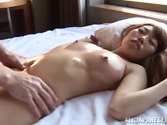 Japanese cutie enjoys massage and gets her pussy smashed