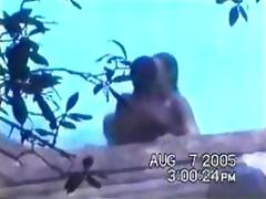 Hidden interracial outdoor sex by the pool