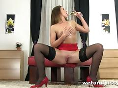 Naty Lee fingers her pussy to orgasm in piss fetish sex tape