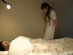 Japanese nurse in uniform gets her hairy pussy feasted doggystyle by patient