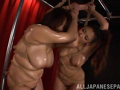 Two chubby tied up Japanese lesbians lick each other's twats