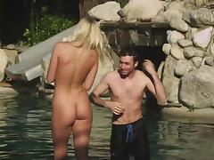 Blonde chick with a shaved pussy enjoying a hardcore fuck next to her swimming pool
