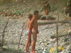 Voyeur on public beach. Blowjobs