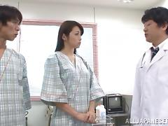 Kinky doctors probe a Japanese girl's hairy pussy in an exam room