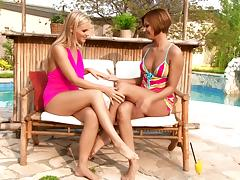 Stunning lesbian babes strip off their swimsuits and fuck poolside