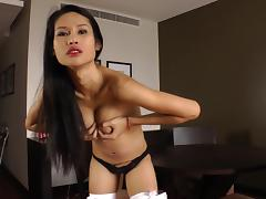 Asian shemale with a hot body playing with her asshole on her bed